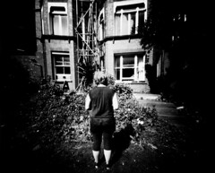 (Yellow Bear) Tags: longexposure blackandwhite plants house selfportrait brick me garden weeds handmade hove scafolding pinhole homemade anonymous shoebox rcpaper 1minuteexposure