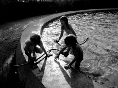 last days of summer (slipper buddha) Tags: reflection water pool kids evening joy hose tenderness cercle teamwork lastdaysofsummer