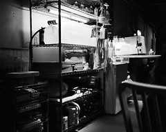 A lab, AS SEEN by a Mamiya 7 rangefinder camera of dubious intent. (J-diggity-dogg) Tags: 120 mamiya water chair lab bottles science 120film depthoffield shelf shelving blackandwhitephotography filmphotography mamiya7 rangefindercamera mediumformatcamera filmvsdigital bwphotograph indoorlighting oldschoolphotography joshdouglas mediumformatbw photoartbloggroup mamiya7rangefinder mamiya7photography mamiyaphotograher mediumformatphoto mediumformatphotograph joshdouglasphotographer mediumformatpicture filmisbetterthandigital mamiyaphotography rangefinderphoto rangefinderpicture