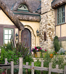 THE FAIRYTALE COTTAGES OF CARMEL-BY-THE SEA (linda yvonne) Tags: california stone cottage carmel stucco cottagegarden interestingness3 i500 storybookstyle storybookhomes lindayvonne eyebrowwindow thefairytalecottagesofcarmelbythesea stakefence roundedwoodendoor rolledcedarshakeroof whimsicalhomes