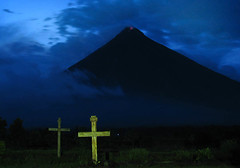 Laments of an Active Volcano (Storm Crypt) Tags: mountain grave night lava evening ruins dusk philippines graves tragedy mayon pilipinas sevenwonders mtmayon mountainrange mountainscape cagsawa stratovolcano albay pyroclastic activevolcano lavadome wowphilippines earthnight cagsawaruinsdaragaalbayphilippines coordinates131657n1237011e