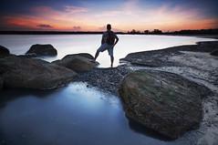 Exploring the shore (Erick Loitiere) Tags: longexposure sunset sea cloud mer selfportrait beach water landscape autoportrait stones shore erick paysage coucherdesoleil lowepro guyane 973 frenchguiana canonef1740mmf4l guyanefranaise 97300 loitiere loweproflipside300 erickloitire singhrayreversedgnd darylbensonfilters lee105mmpolarizer ricoliki explore1thankyou