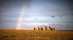 Henge-Bow (Bob Small photography.) Tags: uk england sun moon rain stone rainbow ancient nikon sandstone colours britain religion ruin age stonehenge wiltshire bluestone stoneage sarson worhsip d40 tonemapped