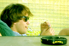 Terrence (sounds.delicious) Tags: summer sunglasses cigarette camel porch