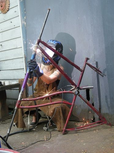 Irondelle Tia welds a tall bike