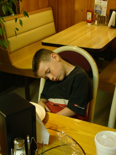 sleepy boy at the pizza place (: