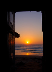 Sunset through the doorway of the R'bat surf grotto (Peace Correspondent) Tags: africa door sunset beach beautiful d50 surf northafrica surfer culture lifestyle surfing atlantic agadir morocco shore getty grotto surfers cave reveal gettyimages northernafrica 5photosaday lagrotte fv50 rbat views4000 soussmassa sousamassa