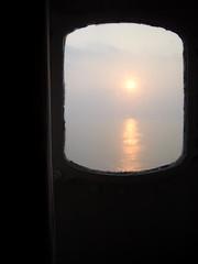 Morning Sun - port hole (mpho3) Tags: china sun hongkong victoriaharbor