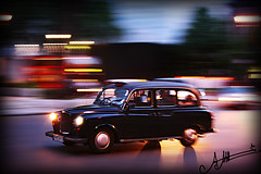 in a Rush .. (A.A.A) Tags: street blur color london colors car by speed canon photography movement focus mark taxi iii move junction khalifa photograph rush panning amna eos1ds abdulaziz althani canoneos1dsmarkiii amnaaalthani