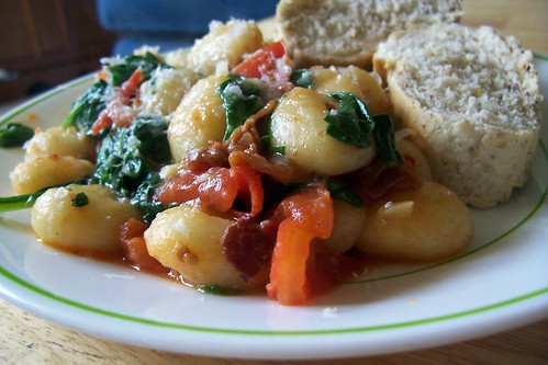 Gnocchi with pancetta, tomatoes and wilted spinach