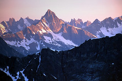 Luna and the Pickets (justb) Tags: pink sunset mountain mountains film colors rock us colorful pointy north rocky peak luna velvia cascades wa fujifilm peaks range picket pickets northcascadesnationalpark justb
