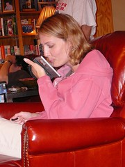 carin playing guitar hero on the DS (alist) Tags: family alist robison alicerobison 66214 ajrobison