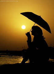 Sunrise Cover (Mitra Mirshahidi-) Tags: sea portrait sky sun black girl yellow umbrella sunrise glow silhouettes reflect cover     lonelygirl     bymitra