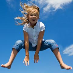 Flying (paul indigo) Tags: girl flying jump movement wind air bounce