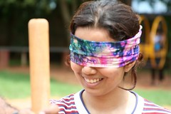 Blind-folded girl with a stick