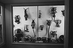 Display of gasmasks, military museum, England (YYL Photography) Tags: uk england blackandwhite bw white black english history film blanco museum zeiss t blackwhite scary war noir mask noiretblanc unitedkingdom britain military negro gas contax masks conflict historical poison notdigital bianco blanc nero biancoenero fumes toosmall contaxt sonnar 38mm negroyblanco yylphotography