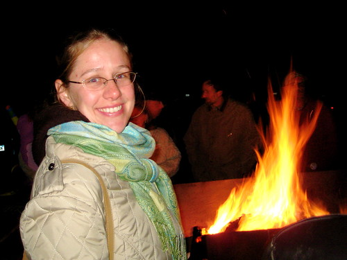 By the fire at the party.