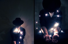 In the sweet Mojave rain ,the boy was on his own (miss sundress) Tags: christmas boy hat lights diptych trilby