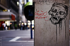 lies here another fallen soldier. (j e h 1 8 2) Tags: street brazil skull 50mm grafitti dof nightshot saopaulo bokeh sampa sp 1855mm trashcan avpaulista canoneosrebelxti400d 74365 jeh182 365nights jeh1822nd streetsidebokeh