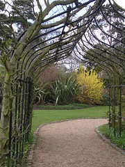 Arch towards nature. (davidezartz) Tags: world uk greatbritain pink blue trees light england plants brown white black green english nature grass sunshine garden way grey nikon iron all arch shadows earth path branches bricks move lincolnshire loveit part bark experience frame poet framework met distillery towards tennyson fades margin gleams goldenglobe e3100 blueribbonwinner alfredlordtennyson somersby supers