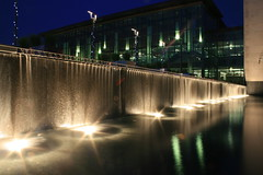 Waterfall at Night, Central Library, Whitby, Ontario (Tony Lea) Tags: plaza new lake chicago ontario man west fall water glass beautiful night lights waterfall downtown pretty published durham library great central lakes first books courtyard made henry nightime whitby boating manmade librarians dewey euclid dundas bookshelves region cascade lakeland shelves modernist cataract centrallibrary dundasstreet cotcmostinteresting abigfave theunforgettablepictures goldstaraward rubyphotographer whitbypubliclibraryfourcorners