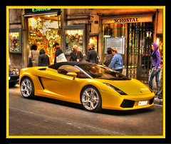 Yellow Lamborghini in Rome (Mike G. K.) Tags: road street windows people italy rome roma window girl car yellow shopping catchycolors lights march hoodie purple frame shops hood jpg walls raining jpeg 2008 lamborghini crusty hdr lamborgini viadelcorso photostop photomatix hdrrides singlejpghdr colourartaward schostal