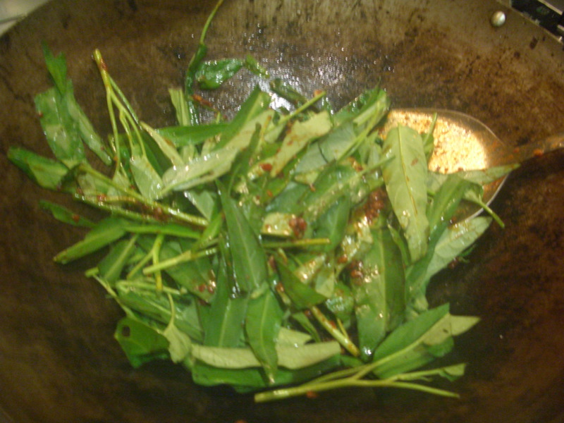 Stir frying kangkung