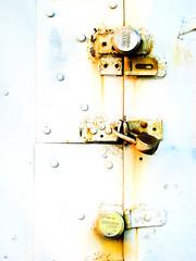 brooklyn locks (alan shapiro photography) Tags: door orange locks highkey lockedup stayaway digitalcameraclub 2010alanshapiro alanshapirophotography wwwalanwshapiroblogspotcom 2010alanshapirophotography