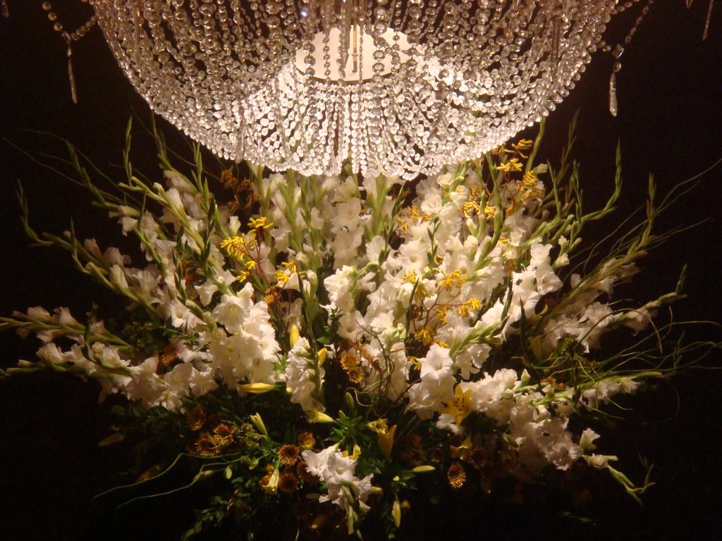 Chandelier and floral arrangement close-up