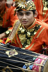 ganteng (Farl) Tags: travel boy bali orange colors leaves indonesia costume culture handsome parade tradition hindu balinese baliartsfestival meped