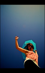 Atmosphere (Cody Bralts) Tags: blue summer sky sun girl umbrella glasses jump sunny clothes parasol