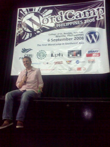 Matt smiles as he listens to a bloggers question