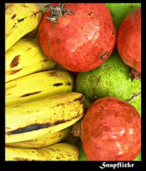 fruit basket - still life (Umang Dutt) Tags: red stilllife food india color colour green yellow fruit contrast lumix interestingness interesting flickr basket bright image vibrant picture pomegranate tasty banana explore pear indians fz5 arranged dutt umang nutrients lumixfz5 umangdutt pcastilllife