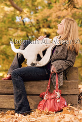 Autumn Laughter (Abdullah AL-Naser) Tags: autumn portrait usa fall beautiful fashion cat canon rebecca westvirginia laugh laughter morgantown 580ex reflector kuwaiti 30d 70200mm abdullah abraj speedlite f28l abraaj alnaser removedfromadobelightroomfortags portraitcatabdullahalnasercanon30d70200mmf28lmorgant