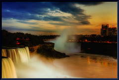 niagara sunset (Wolfgang Staudt) Tags: travel blue panorama usa newyork ontario water colors beautiful yellow fog wow wonderful river lights niagarafalls boat nikon holidays rocks waves darkness nikond70 availablelight sigma waterfalls horseshoe wilderness lovelovelove reflexions vacancy wolfgang americanfalls spotlights peopleschoice niagarariver travelphotographie sixsixsixclub wolfgangstaudt staudt sigmaaf356328300dgmacro superaplus aplusphoto irresistiblebeauty favemegroup6 superhearts themawasserfoto colourartaward artlegacy goldstaraward nikonflickraward grouptripod