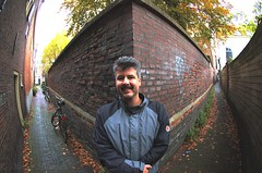 Distorted wide angle fun victim; or explaining the principles of a fish-eye lens. (smiling_da_vinci) Tags: portrait tree me wall leiden alley thenetherlands sigma wideangle smilingdavinci alleys zuidholland eelco 10mm
