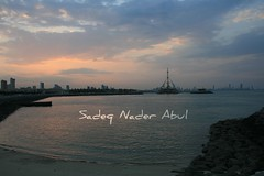 Watch & Think (Sadeq Nader Abul) Tags: sunset sea clouds marina canon eos kuwait nader sadeq   abul    400d