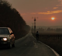 On  the road (Hans van Reenen) Tags: road winter sunset car germany deutschland cyclist sonnenuntergang fav50 fav20 headlight fav30 underway niederrhein fav10 kranenburg cardriver grafwegen fav40 grafwegenerstrasse fav60 fav70 gx100 20081106