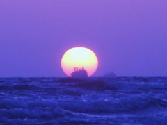 Sleeping sun Behind Ship. (Fayaz Buriro) Tags: sunset karachi clifton sleepingsun dyingsun