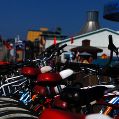 Parked Bicycles. Santa Monica Pier. (.I Travel East.) Tags: california blue red sky bicycle losangeles nikon dof bokeh santamonica depthoffield bicycles santamonicapier cgb losangelescalifornia d80 itraveleast