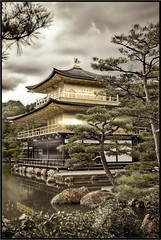 Kinkaku-ji after a monsoon storm (antiquified, hand coloured) ( monkeys with cameras (AKA Marx)) Tags: summer lake postprocessed 20d water weather japan composite architecture clouds photoshop canon garden religious temple eos gold golden pagoda kyoto shrine buddhist canon20d fake buddhism 2006 icon burn monsoon  dodge pavilion desaturated  handcolored  iconic japonica kinkakuji photoshoped buddhisttemple stereotype cliche edit faked kinkaku goldenpavilion religeous handcoloured stereotypical 2870mm anachronistic dodgeburn dodgeandburn canon2870f28l japan2006 kyotofu 2870f28l canonite canonites canon2870mmf28zoom canon2870f28lzoom canon2870f28lserieszoom canon2870mmf28lzoom canon2870mmf28lserieszoom