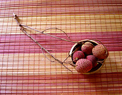 a few litchies (nairvee) Tags: fruits tablemat