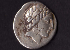 Roman denarius featuring the head of Apollo