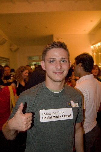 man wearing a shirt that says follow me I am a social media expert