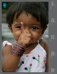 Am gonna telllll........ (:: niKk clicKs ::) Tags: portrait smile canon naughty kid kiss expression niece bangles nikk lachu canoneoskissdigitalx platinumphoto lakshmipriya picnikk amgonnatelllll