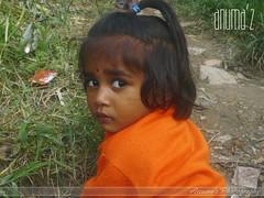 Cute Girl !! (Anuma S. Bhattarai) Tags: nepal boy portrait people orange woman baby man cute girl beautiful face portraits children child faces peoples babygirl kathmandu nepali sharma anuma anumasharma nepalipeoples nepalifaces