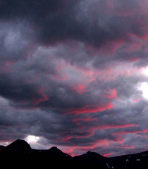East Glacier Sunset, Montana Sky (moonjazz) Tags: pink blue sunset sky mountain black nature crimson clouds dark wonder landscape twilight montana moody quiet glacier explore end vista awe mywinners