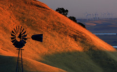 the old and the new (Marc Crumpler (Ilikethenight)) Tags: california usa sunrise canon landscape hiking trails silhouettes windmills hills bayarea eastbay antioch blackdiamond windturbines ebrpd blueribbonwinner contracostacounty eastbayregionalparkdistrict canon70300isusm sfchronicle96hours 40d mywinners abigfave ebparks platinumphoto canon40d betterthangood theperfectphotographer goldstaraward ebparksok