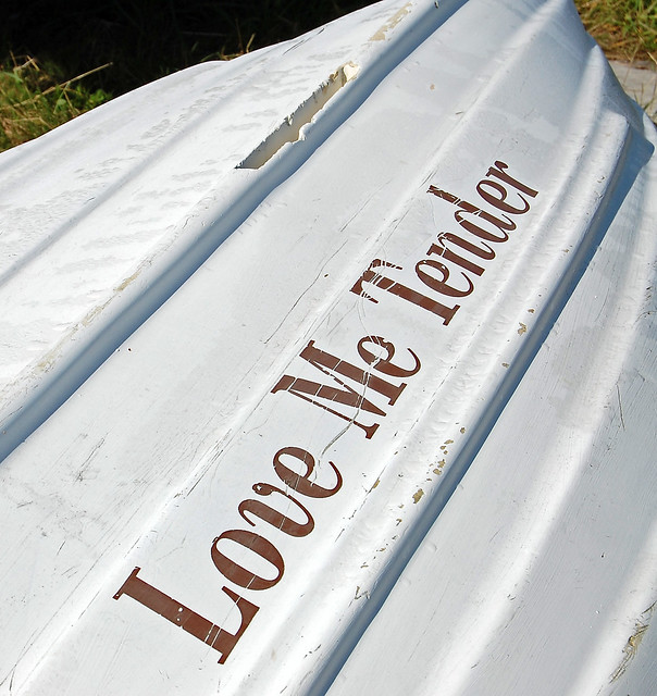 Love Me Tender name on boat