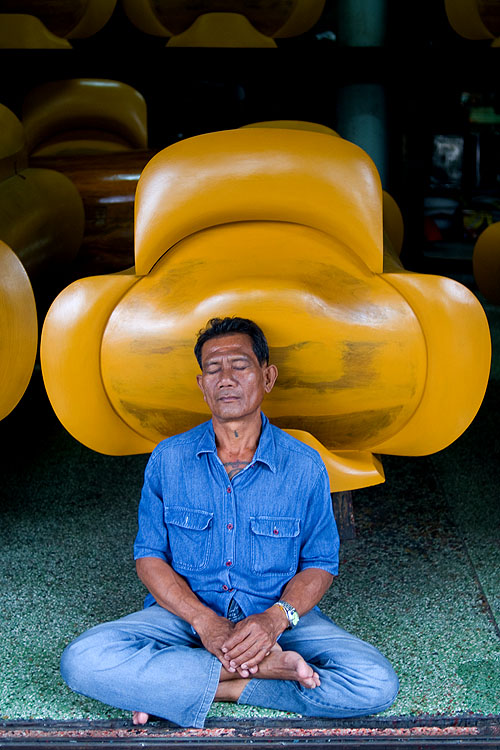 Man napping in front of a coffin maker's shop, Chinatown, Bangkok